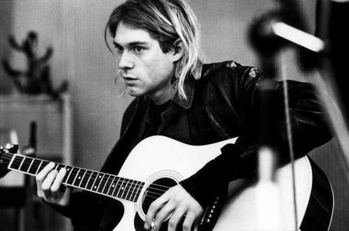 NETHERLANDS - NOVEMBER 25:  HILVERSUM  Photo of Kurt COBAIN and NIRVANA, Kurt Cobain recording in Hilversum Studios, playing Takamine acoustic guitar  (Photo by Michel Linssen/Redferns)